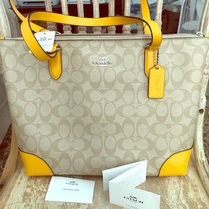 Coach leather tote bag with tags yellow details